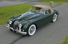 1959 Jaguar XK150; rag-top and English racing green.....yep.