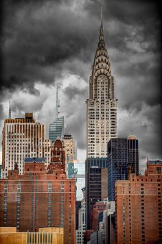 NYC. Manhattan buildings look like turning their weapons against the ominous sky