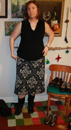 Sleeves black top (has ruffle detail along split) and black-grey-white pattern skirt. Boots. (I didn't feel like taking stockings or tights on and off, so imagine them on my pale legs.)