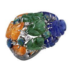 Bague Haute Joaillerie Bague Pushkar - or gris, grenats mandarin gravés, grenats tsavorite gravés, tanzanites gravées, opales noires taille cabochon, diamants taille brillant.
