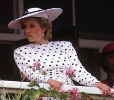 Diana watches a race at Epsom Downs in Surrey on June 4, 1986.