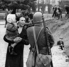 A woman with her baby is asking a Polish soldier about the situation on the front. Warsaw, September 1939.