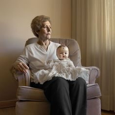Uncanny Portraits of Older Women With Their Childhood Dolls by photographer Vera Saltzman