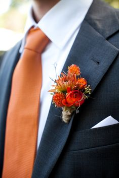 Fall wedding boutonniere. Burnt orange groomsman