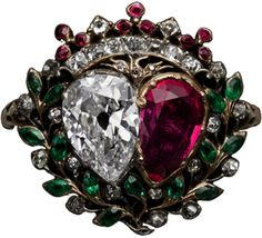 Love Ring.Mid-18th century. An eighteenth-century French gold, silver, diamond, ruby and emerald ring in the form of two hearts framed by leaves and berries of the myrtle plant (symbol of marriage), surmounted by a viscount's crown.