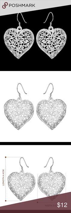 "Hollow heart silver earrings Silver plated hollow heart earrings. Length 1.7"" X Width 1.18"". Very lightweight and delicate. Jewelry Earrings"