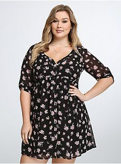 "<p>Floral print keeps this shirtdress flowy, the button-front is all business. Black semi-sheer chiffon stays modest with the solid black slip underlay. The shirtdress style has a professional vibe with 3/4 sleeves, while the flared skirt is ready for a spin.</p>  <p> </p>  <p><b>Model is 5'11"", size 1</b></p>  <ul> 	<li>Size 1 measures 38 1/4"" from shoulder</li> 	<li>Polyester</li> 	<li>Wash cold, dry flat</li> 	<li>Imported plus size dress</li> </ul>"