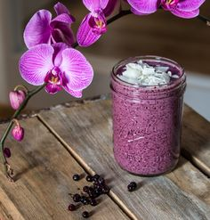 Pretty blueberry smoothie full of berries, coconut milk, spinach, oats, and 18 grams of protein—not to mention great little boosters like shredded coconut and chia seeds..
