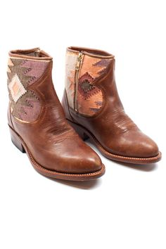 Pair these handmade leather soled boots with a pair of black denim jeans and a gray tee.