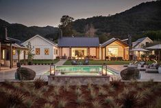 Modern farmhouse with a backyard that's to die for. backyard farmhouse Considerations for Creating Your Perfect Outdoor Space Modern Farmhouse Exterior, Farmhouse Plans, Farmhouse Design, Dream House Exterior, House Exteriors, Modern House Design, Modern Houses, Home Fashion, Architecture