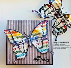"Rainbow Swallowtail Flies The Coop. I used the ""kissing"" technique with Stampin' Up's Brushstrokes and Swallowtail background stamps and the ink pads from SU's Regals color collection. ""With Sympathy"" sentiment from SU's Rose Garden stamp set. Background is DSP layered with an embossed acetate sheet. Embossing folder used is Cuttlebug's Chicken Wire but SU's Honeycomb Textured Impressions embossing folder would be a great substitute. Enjoy!"