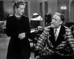 Bette Davis (underplaying for once) and Monty Woolley in the sharp-witted The Man who Came to Dinner, 1942.