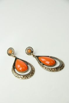 Orange is one of the season's hottest colors! Stand out with these teardrop orange and gold detail earrings. A fun approach to rocking these? Grab an orange clutch and match!  $12.75