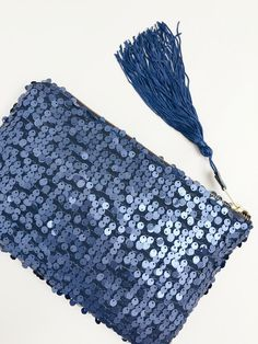 Elektra clutch.  Add a bit of sparkle and whimsy to your next special occasion, or simply look effortless stylish while you are sipping your Chardonnay, watching a beautiful California sunset.  - Handmade item. - Matte-finish sequins. - Brass zipper with blue tassel detail - Fully lined.  Dimensions: 10 wide x 6.5 tall  This item is Handmade with love, under a sunny California sky. All the materials are hand picked at the local shops and/or from fellow Etsy sellers.  ©2016 The Resort…