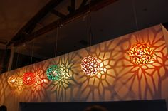 There is nothing like the glow/shadow effect of a myriad colorful David Trubridge lamps! #lighting #design #decor #ecoDesign