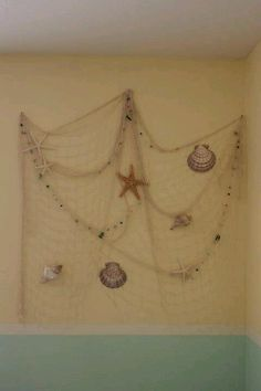 fishing net with starfish- can hang on the walls and places quotes, pictures, anecdotes, on starfish shaped paper etc. :)