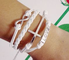 Antique Silver Infinity Cross Cotton Braided Rope Leather Bracelet from lavagrantbelle shop