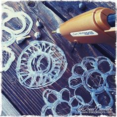 hot glue as handmade stencils- trying this as soon as I find my glue gun!