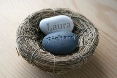 Our Nest Our Home -  Custom engraved couple's name on nest - original creation by sjengraving.  Your custom names will be carved on two contrasting colors of natural river rocks - deep gray and white to symbolize the individuality and unity of two soul mates in one love nest.  It's a perfect gift for any couple whatever the occasion might be.  #wedding #caketoppers