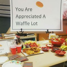Waffle Bar for Teacher Appreciation Breakfast. Included various fruits, chocolate chips, syrup, butter, cream cheese whipped cream, juice, muffins, and bagels. (teacher potluck ideas)