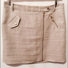 "J. Crew Tan Linen Zippered Mini Skirt Fully lined, functional pockets with exposed gold tone zipper closure. Never worn.   100% linen 100% poly lining   Dry clean   17"" overall length 42"" sweep J. Crew Skirts Mini"