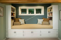 A roomy window seat bench offers a cozy space for reading, while the built-in bookshelves and cupboards surrounding it provide ample storage...  Upstairs main bedroom???