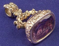 Antique 18kt Gold and Amethyst Intaglio Fob, with engraved floral and foliate motifs, lg. 1 1/4 in.