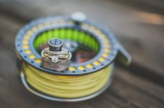 Fly fishing wedding ring reel!   Captured by Joelsview Photography in British Columbia | www.joelsview.com