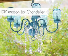 DIY Mason Jar Chandelier - Here is what I did to turn a thrift shop chandelier into a DIY Mason Jar Chandelier, which we hung above our sweetheart table.