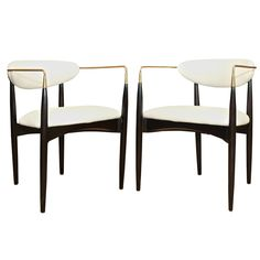Pair of Kofod Larsen Chairs in Wood and Brass | From a unique collection of antique and modern armchairs at http://www.1stdibs.com/furniture/seating/armchairs/
