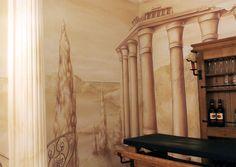 Gestaltung eines Weinkellers mit griechischen Stilelementen.