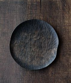 maker Yoshiaki Tadaki delicately carved plate is finished using the technique of fuki- urushi which involves repeatedly applying and wiping off the lacquer revealing the natural wood grain below: