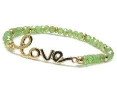 Love gold and green crystlas elastic bracelet.  $12.00