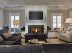 Seaside Shingle Coastal Home Navy Family Room. Navy and white family room. Navy and white family room decor. Navy and white family room furniture. Navy and white family room decorating ideas. Navy and white family room color scheme Fireplace Windows, Living Room With Fireplace, Fireplace Mantels, Fireplaces, Fireplace Ideas, Fireplace Box, Craftsman Fireplace, Fireplace Seating, Coastal Living Rooms