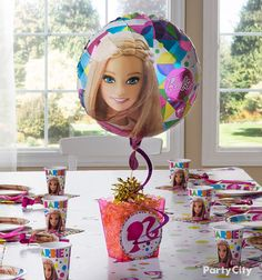 DIY a few fashionable Barbie birthday centerpieces! Get the cutest accessories like balloons, ribbons, and more at Party City.