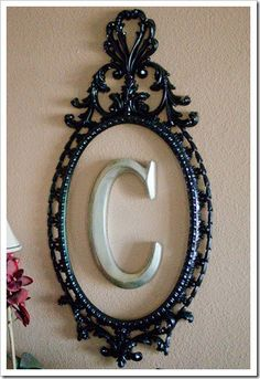 what a great idea. an old mirror frame with you inital inside..too cute!!!!!  @Corrie Collier  don't you have an empty frame like this?