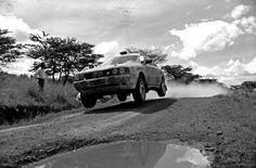 AFRICA,KENYA - Safari Rally Car no 2, Peugeot 504 coup, fly 's past flooded roads near Mathatani in Eastern province on its way to Nairobi at the end of the first leg in 1978.