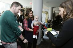 Tiffani Thiessen and Brady Smith take their kids Harper and Holt to Santa's Secret Workshop on December 5, 2015