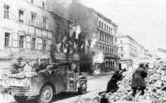 Soviet troops in US-built M3A1 scout car fighting in Vienna Austria April 1945