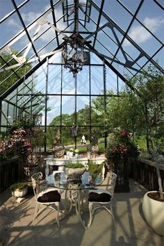 enjoy morning tea in a greenhouse full of salvaged ironwork accents…