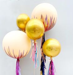 Hand Painted Ballons with gold globes and tassels Jumbo Balloons, Gold Globe, Balloon Tassel, Balloon Painting, Balloon Installation, Globes, Tassels, Chandelier, Hand Painted