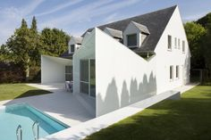 Transitional Home Architecture with Outdoor Pool Addition: Pointed Architectural Wall Combined With A Frame Gable With Some View Windows Cre...