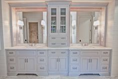 Bathroom Tower Cabinet Gorgeous Double Vanity With Center Tower For Extra Storage By Custom Cabinets Inc Bathroom Linen Cabinet White Master Bathroom Vanity, Double Sink Bathroom, Modern Bathroom, Double Sinks, Bathroom Ideas, Bath Ideas, Bathroom Vintage, White Bathrooms, Budget Bathroom