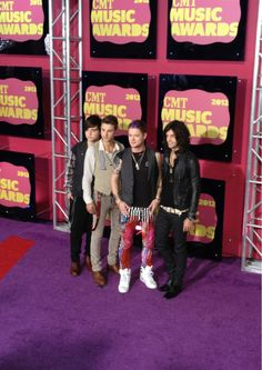 Hot Chelle Rae on the red carpet. Loving those colorful pants! #CMTawards #HotChelleRae