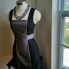 FOREVER 21..CUTE ..GRAY /BLACK .DRESS EXCELLENT CONDITION.. .....LIKE NEW. .....NO FLAWS....... .....CUTE  .... 2 PIC.. up close. .... true to its size and color. .... TRUE TO ITS SIZE.....X SMALL ......zipper back. .zipper goes all the way down ..... short dress tight on body. ..... MTRL....65%polyester 35%rayon.. ......better in person.. Forever 21 Dresses
