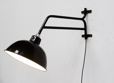Enamel light with extension arm.
