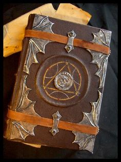 perhaps this or something more vampire-ish for the Count to write in.of course he also should have quill and ink Halloween Spell Book, Halloween Spells, Fete Halloween, Quill And Ink, Magick Book, Leather Bound Journal, Medieval Books, Larp, Cool Books