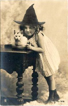 I love this vintage photo of a little girl in a witch hat holdering her white kitten!!! Adorable for Halloween!!!