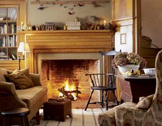 The original charm of the grain-painted woodwork, including the mantel, was kept intact in this Federal-style brick home.