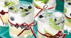 Trude would love these! Canadian Mojito: Rye and blueberries add a Canadian twist to this traditional Cuban cocktail. Garnish each glass with skewered blueberries and mint sprig. Canadian Living Recipes, Canadian Cuisine, Canadian Food, Refreshing Cocktails, Fun Drinks, Yummy Drinks, Alcoholic Drinks, Beverages, Cocktail Garnish